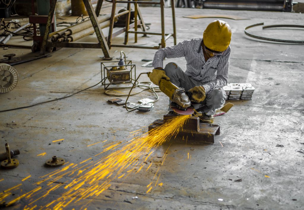 Industrial worker working with the metal